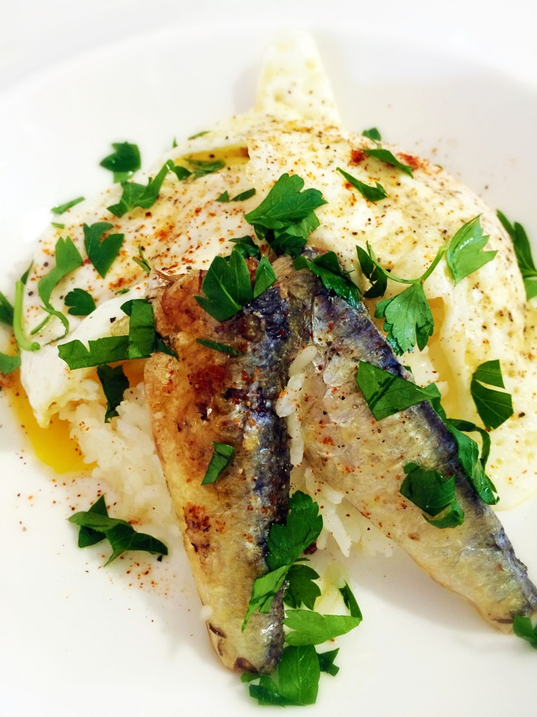 Sardines in Spicy olive oil, eggs over rice.